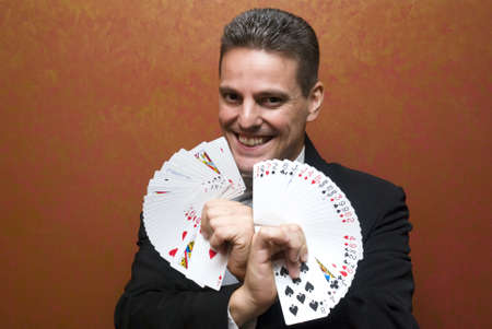 Magician performing with cards Stock Photo - 10718828