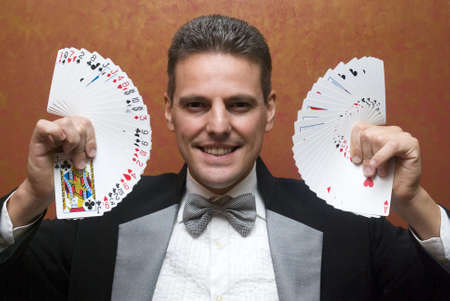 deceive: Magician performing with cards