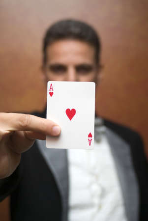 deceive: Magician performing with card Stock Photo