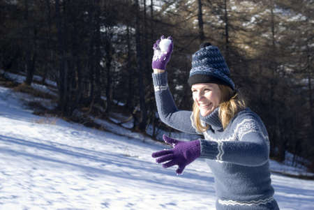 Woman throwing snowball