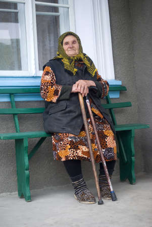 Poor elderly woman of Eastern Europe photo