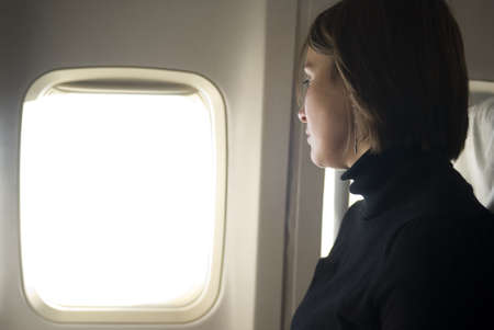airplane window: Woman traveling by air
