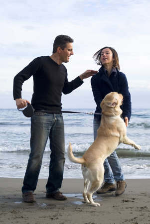 Happy couple with their labrador photo