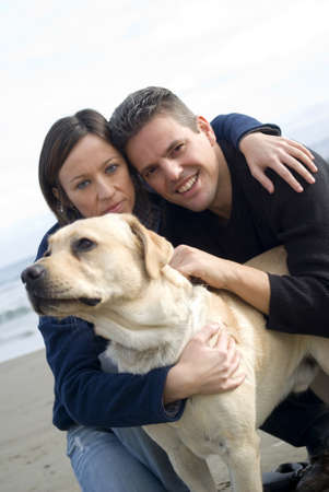 Happy couple with their labrador photo