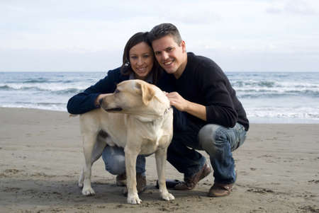 Happy couple with their labrador Stock Photo - 11558325