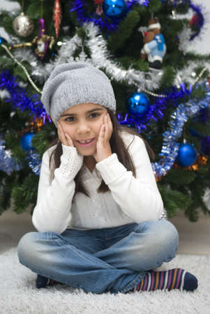 Adorable girl waiting for Santa photo