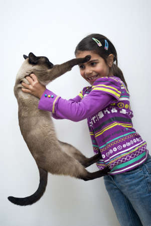 Little girl with siamese cat photo