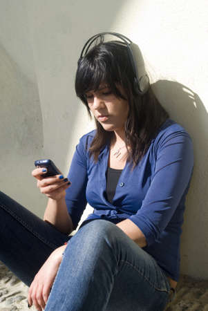 Teenage girl using a cell phone photo
