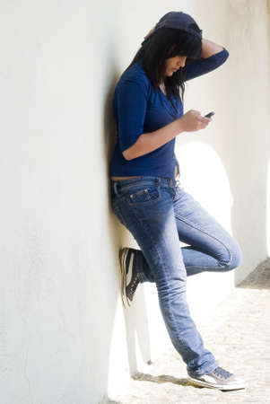 Teenage girl using a cell phone Stock Photo