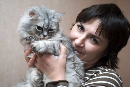 Woman with cat 스톡 콘텐츠