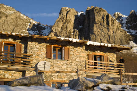 refuge: The mountain hut at sunrise Stock Photo