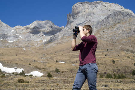 Mountain hiker looking through binoculars Stock Photo - 13033587