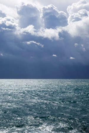 Sea under stormy sky