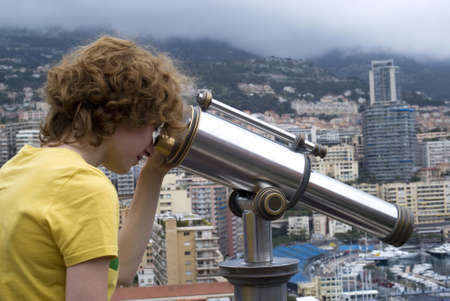 Tourist using coin telescope photo