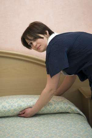Maid making hotel bed Stock Photo - 13748680