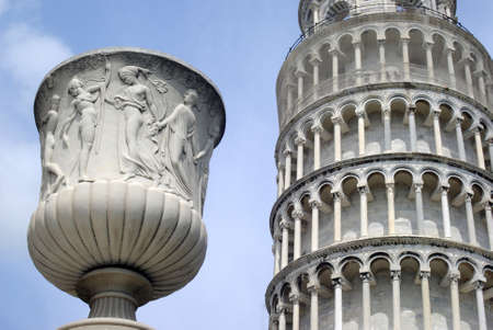 The Leaning Tower with a statue in foreground, Pisa, Italy photo
