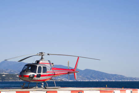 heliport: Helicopter on a landing area