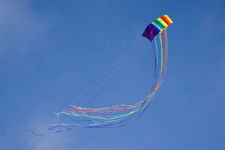 Colourful kite in sky photo