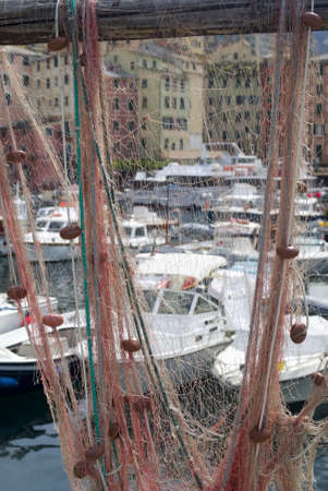 Fishing nets at old port of Camogli, Italy photo