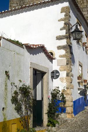 Obidos, Portugal � November 24, 2010: Picturesque village and tourist destination