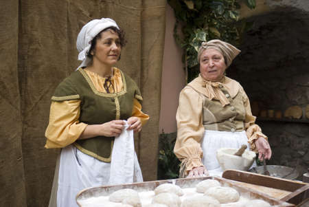 Taggia, Italy – February 27, 2011: Participants of medieval costume party. This image: Bakers  Stock Photo - 17249538