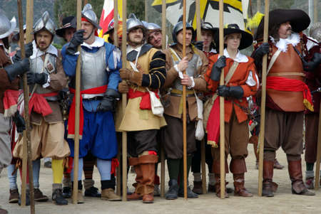 Taggia, Italy � February 28, 2010: Participants of medieval costume party. This image: Medieval soldiers Stock Photo - 17249531