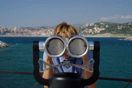 Boy looking through a telescope Stock Photo - 17254109