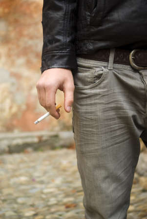 Teenage boy smoking photo