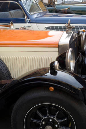 of yesteryear: Imperia, Italy � October 19, 2013  Row of vintage cars parked in a street during raid of vintage cars