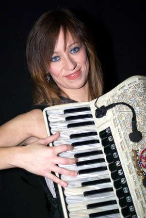 Woman with accordion photo