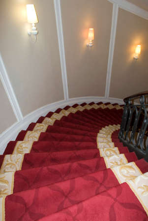 Seville, Spain - November 5, 2012  Staircase covered with red carpet in a hotel in Seville