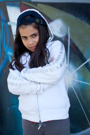 Girl standing against graffiti wall photo