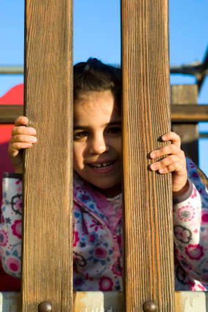 Little girl at playground photo