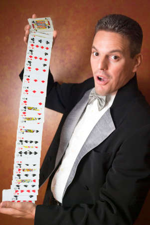 Magician performing card trick photo