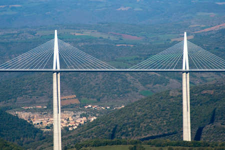 millau: Millau, France - October 23, 2014: View of the Millau Viaduct, the tallest cable-stayed bridge over the Tarn valley in France, designed by the structural engineer Michel Virlogeux and architect Norman Foster Editorial