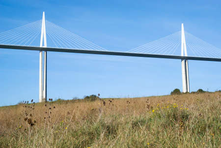 millau: Millau, France - October 23, 2014: View of the Millau Viaduct, the tallest cable-stayed bridge over the Tarn valley in France, designed by the structural  engineer Michel Virlogeux and architect Norman Foster
