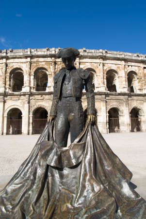 bullfighter: Statue of famous bullfighter in front of the arena in Nimes, France