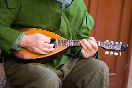 mandolin: Playing mandolin Stock Photo