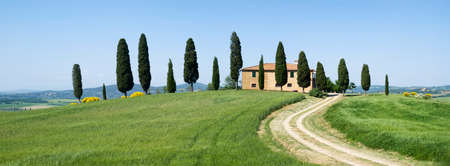 orcia: San Quirico Orcia, Italy. May 18 2015: A typical rural country house located in the countryside of Tuscany near San Quirico dOrcia in the famous area on the hills of Siena called Crete Sianesi