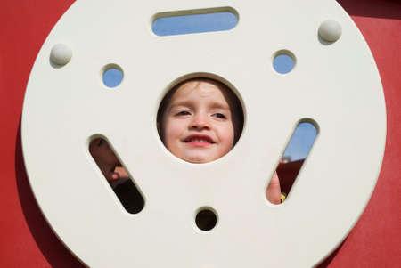 caucasian girl: Caucasian girl playing on playground