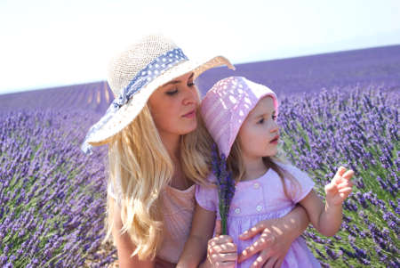 pretty little girl: Mother with daughter in lavender field