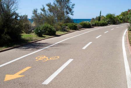 straight path: Bike path near the sea coast