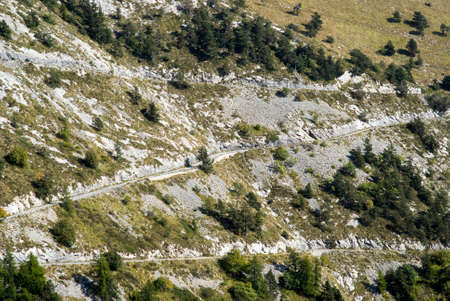 unpaved road: Unpaved road through mountains