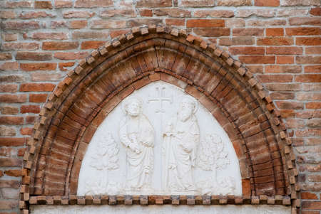 saints peter and paul: Particular of portal the Church of Saints Peter and Paul. Chioggia, Italy Stock Photo