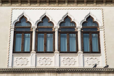 typical: Chioggia, Italy. Typical windows in Venetian style Stock Photo