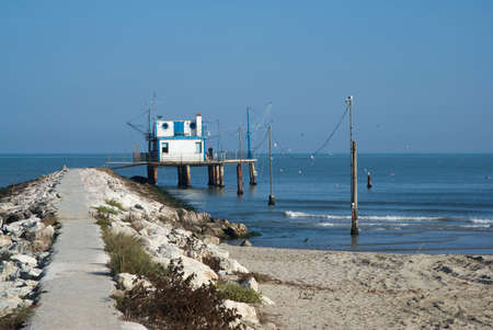 stilt house: Adriatic, Italy. Stilt house by the sea and fishing nets