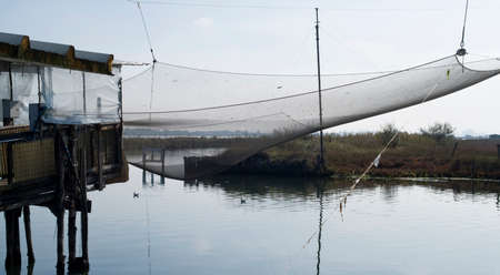 stilt house: Stilt house and fishing nets along the Po Delta. Italy Stock Photo