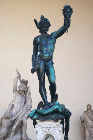 renaissance art: Florence, Italy - October 30, 2015: Perseus with the Head of Medusa is a bronze sculpture made by Benvenuto Cellini in 1545. Displayed in the open-air gallery of antique and Renaissance art Loggia dei Lanzi in Florence Editorial