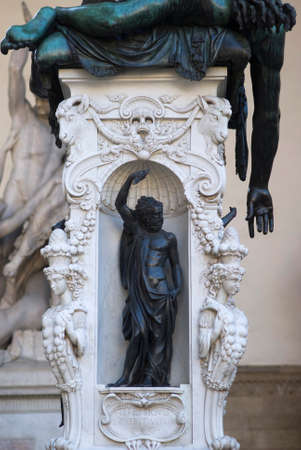 renaissance art: Florence, Italy - October 30, 2015: The base of the sculpture, Perseus feet on the slain Medusa made by Benvenuto Cellini in 1545. Displayed in the open-air gallery of antique and Renaissance art  in Florence