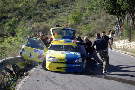 crashed: Sanremo, Italy October 12, 2013: 55th edition of the Sanremo Rally, European Rally Championship Citroen Racing Trophy, Trophy Gordini Twingo R2. A. Zerbini driver and co-driver S. Gallotti crashed his car Citroen Saxo A6 During the ascent to the mountain